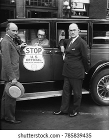 Bureau of Prohibition car used by Treasury agents when stopping suspected vehicles. L-R: Prohibition Administrator Ames Woodcock; H.M. Lucious, Secretary of the Automobile Club of Maryland; and Ernest