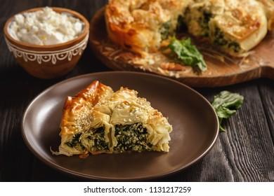 Burek or borek, balkanian puff pastry with spinach.