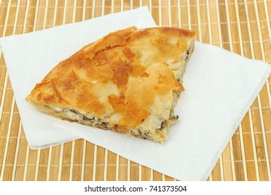 burek or pie with cheese and mushrooms on a paper serviettes