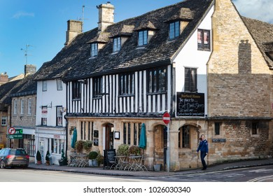 BURFORD, UK - FEBRUARY 15th, 2018: Burford is a medieval town on the River Windrush in the Cotswold hills in West Oxfordshire, England. It is often referred to as the 'gateway' to the Cotswolds.