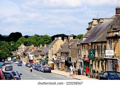 BURFORD, UNITED KINGDOM - JUNE 17, 2014 - Shops along the High Street, Burford, Oxfordshire, England, UK, Western Europe, June 17, 2014.