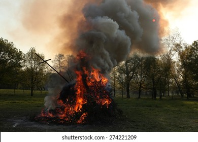 BURG, GERMANY - APRIL 23, 2011: Traditional Easter bonfire in the Lusatian village of Burg in Spreewald Region, Lower Lusatia, Brandenburg, Germany.