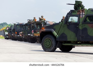 BURG / GERMANY - JUNE 25, 2016: german military army convoy, stands on open day in barrack burg / germany at june 25, 2016