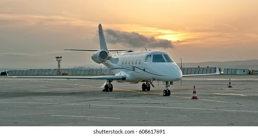 Burgas airport, Bulgaria - May 22, 2015: Airplane on the apron against beautiful sunset. The Gulfstream G150 is an Israel Aerospace Industries-manufactured twin-engine business jet.