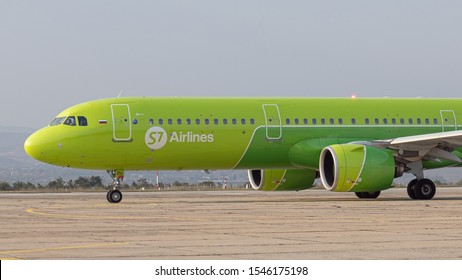 Burgas airport, Bulgaria - Oct 11, 2018: Commercial passenger jet airliner Airbus A321-200 of S7 Siberia Airlines on apron after landing, side view. Fast transport, business travel, charter flights