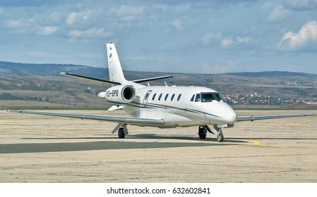 Burgas airport, Bulgaria - Sept 14, 2015: Turbofan-powered, medium-sized business jet airplane Cessna Citation Excel (C560X) is taxiing on the apron after landing at the sunny airport. Travel concept