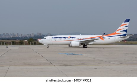 Burgas airport, Bulgaria - Sept 5, 2018: White commercial passenger jet airliner Boeing 737 MAX 8 of Czech Smartwings Airlines taxiing for take off. Fast transport, business travel, tourism charter.