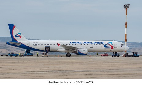 Burgas airport, Bulgaria - Sept 5, 2018: Commercial passenger jet airliner Airbus A321-200 of Ural Airlines on apron with airport service, side view. Fast transport, business travel, charter flights.