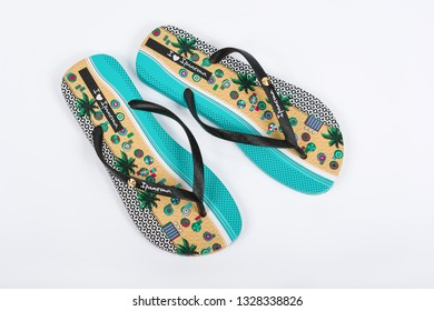 BURGAS, BULGARIA - AUGUST 18, 2018: Multicolor Ipanema fashion flip flops on white background. Ipanema Slippers. Ipanema is a Brazilian company, the world leader for the flip flops market.