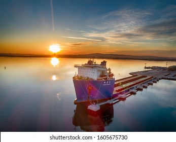 BURGAS, BULGARIA - Januari 04, 2020:The Cargo Ship is in the Port Burgas at the Loading . Aerial View from Drone at sunset. Location Burgas Town, Bulgaria