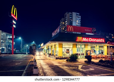 BURGAS, BULGARIA - JANUARY 23, 2019:. McDonald's McDrive restaurant at night non stop working.