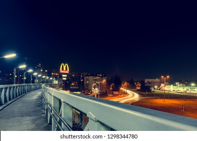 BURGAS, BULGARIA - JANUARY 23, 2019:. McDonald's restaurant logo at night glowing.