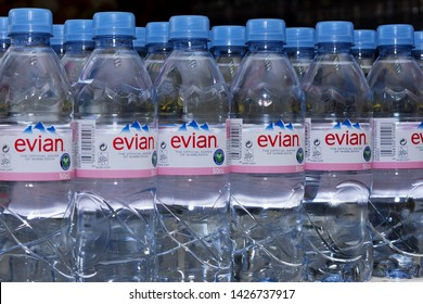 Burgas, Bulgaria - JUNE 16, 2019: Evian is a brand of mineral water made in France on the south shore of Lake Geneva owned by multinational corporation Danone