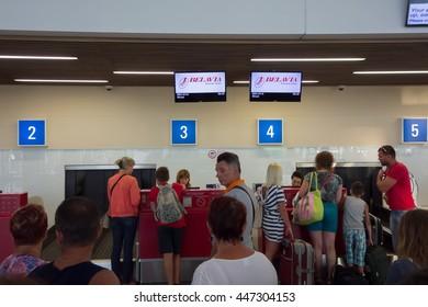 Burgas, Bulgaria - June 19, 2016: Passengers queue up for registration on the flight