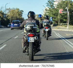 BURGAS, BULGARIA - OCTOBER  9, 2017 : Two policeman on a motorcycle during busy traffic in the city