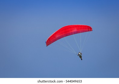 Burgas - July 29: Red paraglider flying against the blue sky on July 29, 2016, Burgas, Bulgaria
