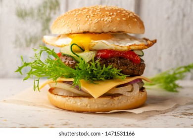 Burger with beef and cheese close-up