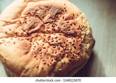 Burger bun with sesame seeds - top view
