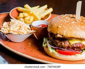 Burger, cabbage salad and French fries