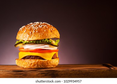 Burger cheeseburger with cutlet, cheese and lettuce