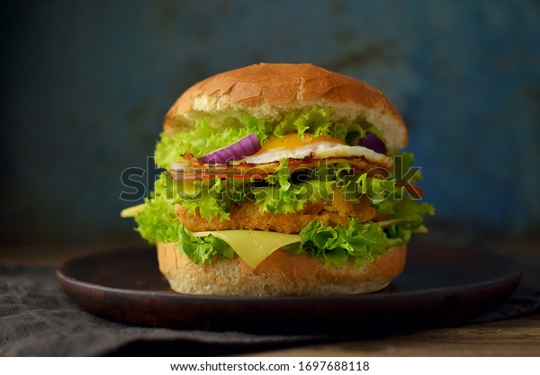 Burger with egg and vegetables