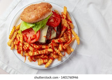 burger and french fries. the concept of junk food. top view. white background. Copy space for your text