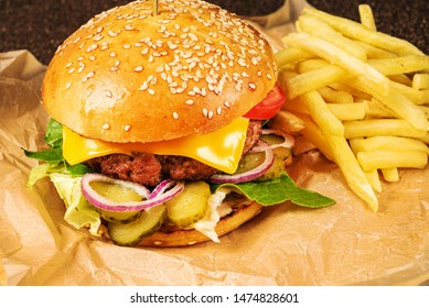 burger with french fries on parchment