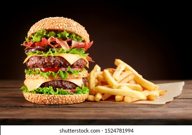burger with french fries on wooden background