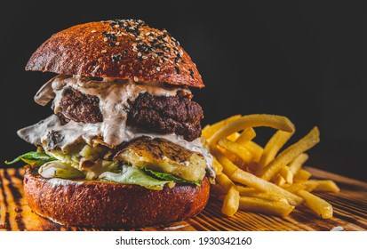 burger and french fries on wooden table. fast food
