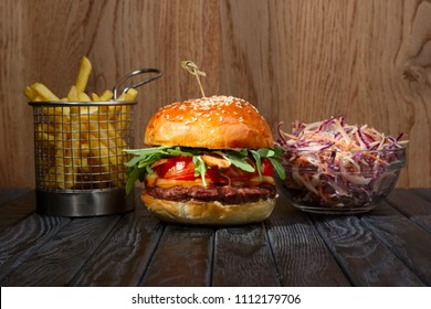Burger with french fries and red cabbage salad