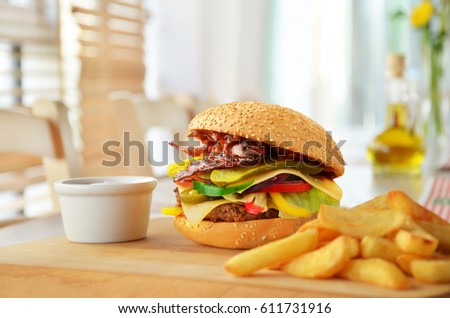 Burger with french fries in restaurant.