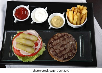 Burger, french fries and sauces from top view
