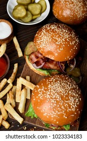 Burger and french fries. Top view, flat lay. Focus on middle burger