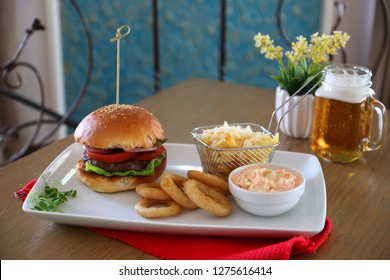burger with fries and coleslaw