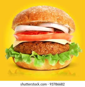 Burger isolated on yellow background. Fast food meal.