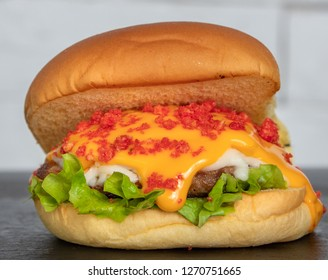 Burger with melted Cheese and Cheetos
