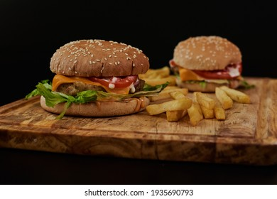 Burger on a black background. the most delicious beef burgers