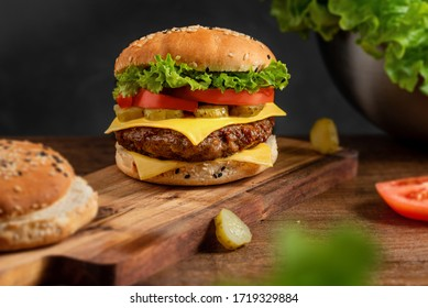 burger on the board on a dark background