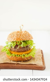 Burger on white background, copy space, rustic style