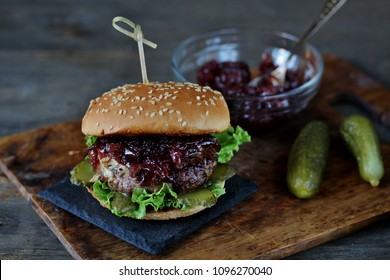 burger with onion red marmalade.