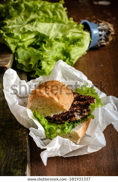 Burger (sandwich) with a cutlet and lettuce