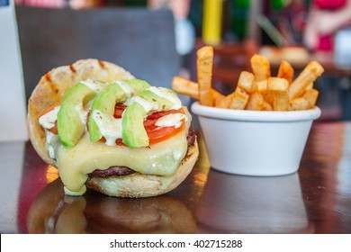 burger with tomato and avocado steak pie baked on grill.