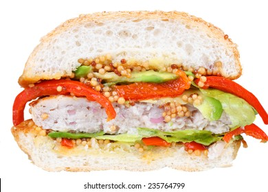 Burger with turkey, avocado, lettuce, onions, red paprika pepper on a sesame seed bun. Isolated on white background