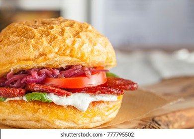 Burger with turkish salami, also calles Sucuk