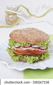 Burger vegetable with lettuce, tomato, radish, alfalfa and a bread roll round, vegetarian food