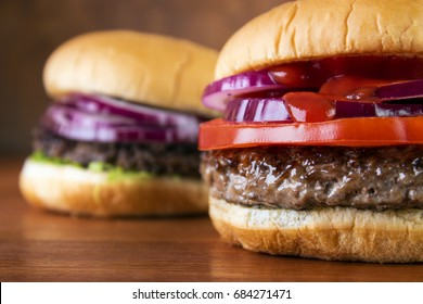 Burgers closeup on wooden table , shallow DOF