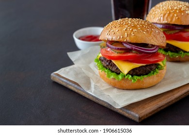 Burgers with cutlet, tomato, lettuce, cucumber, onion and cheese. American cuisine Fast food Cheeseburger