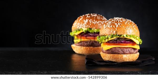 burgers hamburgers cheeseburgers on a black background