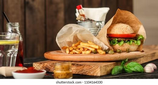 burgers on a slate plate  - fast food (sandwich) - cuisine.  Food background