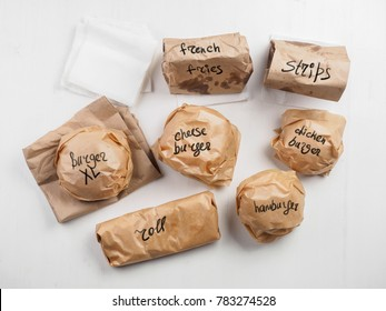 Burgers roll french fries strips on paper package with inscription